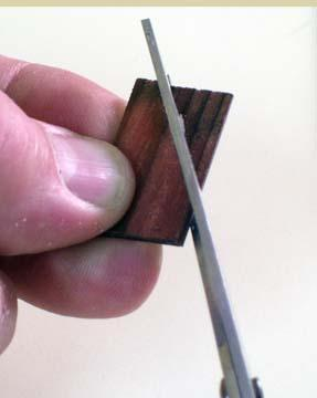 If you cut shingles with scissors, always start at the short-grain and finish on the long-grain (as for the piece on the left in this picture).  The piece on the right will splinter...